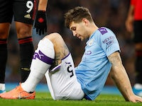 John Stones sits injured for Man City on December 7, 2019