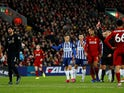 Liverpool's Alisson is shown a red card by referee Martin Atkinson on November 30, 2019