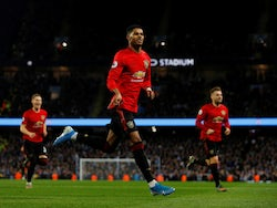 Marcus Rashford celebrates scoring the opener during the Premier League game between Manchester City and Manchester United on December 7, 2019