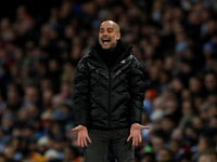 Pep Guardiola watches on during the Premier League game between Manchester City and Manchester United on December 7, 2019
