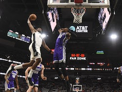 San Antonio Spurs forward Rudy Gay (22) dunks over Sacramento Kings forward Richaun Holmes (22) in the first half at the AT&T Center on December 7, 2019