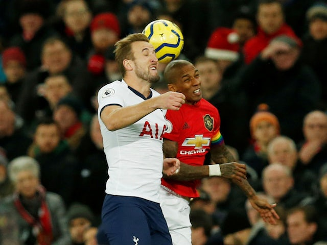 Manchester United's Ashley Young in action with Tottenham Hotspur's Harry Kane in the Premier League on December 4, 2019