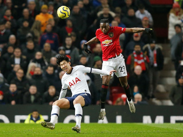 Manchester United's Aaron Wan-Bissaka in action with Tottenham Hotspur's Son Heung-min in the Premier League on December 4, 2019