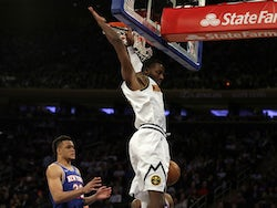 Denver Nuggets guard Will Barton (5) slam dunks the ball over New York Knicks forward Kevin Knox II (20) during the first half at Madison Square Garden on December 6, 2019