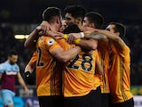 Wolverhampton Wanderers' Leander Dendoncker celebrates scoring their first goal with teammates on December 4, 2019