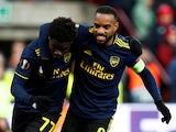 Arsenal's Bukayo Saka celebrates scoring their second goal with Alexandre Lacazette on December 12, 2019