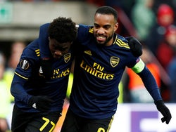 Arsenal's Bukayo Saka celebrates scoring their second goal with Alexandre Lacazette on December 12, 2019
