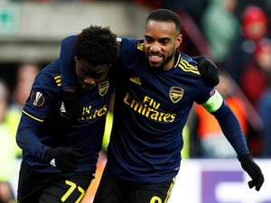 Arsenal come from two down to rescue top spot in Europa League group