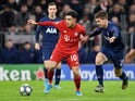 Philippe Coutinho is given a tug by Juan Foyth on December 11, 2019