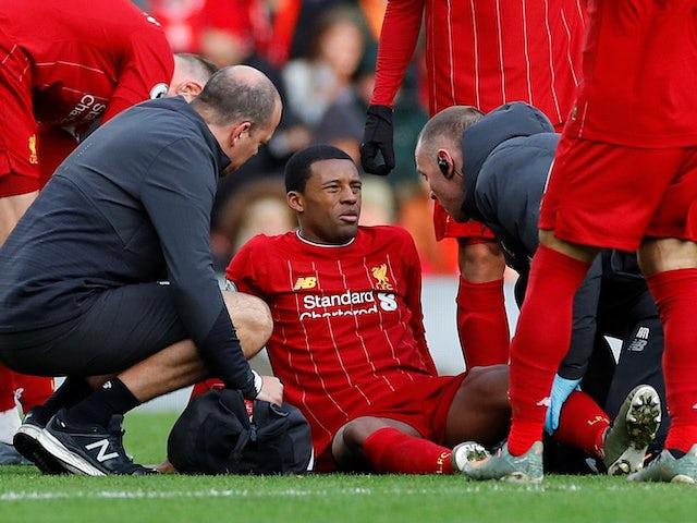 Georginio Wijnaldum sits injured for Liverpool on December 14, 2019