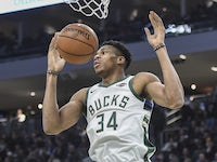 Milwaukee Bucks forward Giannis Antetokounmpo (34) dunks a basket in the fourth quarter during the game against the Cleveland Cavaliers at Fiserv Forum on December 15, 2019