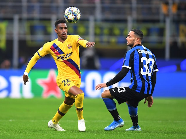 Danilo D'Ambrosio and Junior Firpo in action during the Champions League game between Inter Milan and Barcelona on December 10, 2019