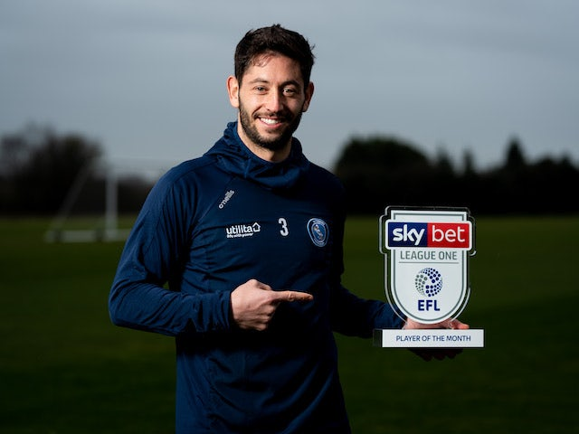 Joe Jacobson celebrates with his League One player of the month award for November 2019