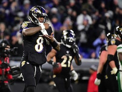 Baltimore Ravens quarterback Lamar Jackson (8) celebrates after throwing a touchdown pass in the fourth quarter against the New York Jets at M&T Bank Stadium on December 13, 2019