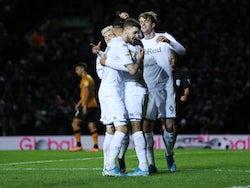 Leeds players celebrate scoring against Hull on December 10, 2019