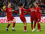 Liverpool's Naby Keita celebrates scoring their first goal with Roberto Firmino and teammates on December 10, 2019