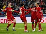 Liverpool's Naby Keita celebrates scoring their first goal with Roberto Firmino and teammates on December 10, 2019