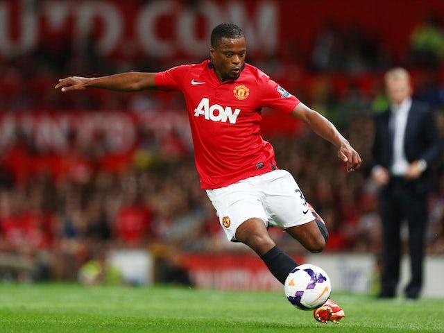 Ferdinand picks Evra over Robertson