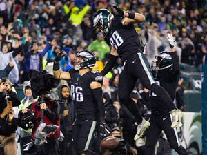 Eagles keep playoff hopes alive with overtime win against Giants