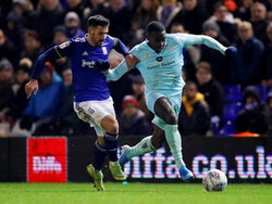 Queens Park Rangers' Bright Osayi Samuel in action with Birmingham's Maxime Colin on December 11, 2019