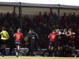Munster medic Jamie Kearns (L) with referee Pascal Gauzere as players including Saracens' Jamie George clash on December 14, 2019