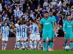 Real Sociedad's Mikel Oyarzabal celebrates scoring their first goal with teammates on December 14, 2019