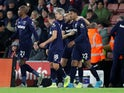 West Ham United's Sebastien Haller celebrates scoring their first goal with teammates on December 14, 2019