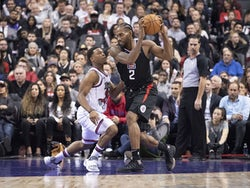 LA Clippers forward Kawhi Leonard (2) controls a ball as Toronto Raptors guard Kyle Lowry (7) tries to defend during the third quarter at Scotiabank Arena on December 12, 2019
