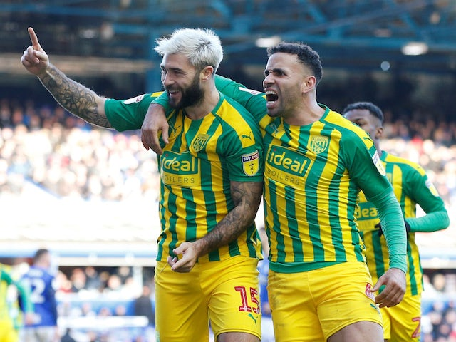 West Bromwich Albion's Charlie Austin celebrates scoring their second goal with Hal Robson-Kanu on December 14, 2019