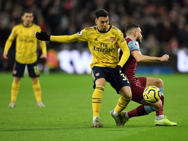 Arsenal's Gabriel Martinelli in action with West Ham United's Robert Snodgrass in the Premier League on December 9, 2019