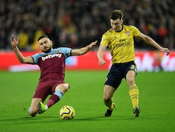 Arsenal's Kieran Tierney in action with West Ham United's Robert Snodgrass in the Premier League on December 9, 2019