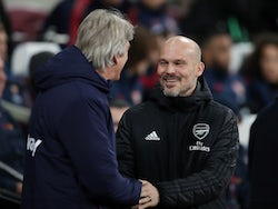 West Ham United manager Manuel Pellegrini with Arsenal interim manager Freddie Ljungberg on December 9, 2019