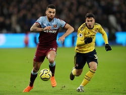 West Ham United's Ryan Fredericks in action with Arsenal's Gabriel Martinelli in the Premier League on December 9, 2019