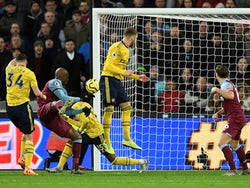 West Ham United's Angelo Ogbonna scores against Arsenal in the Premier League on December 9, 2019