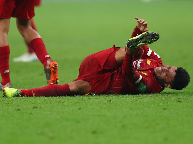 Liverpool's Alex Oxlade-Chamberlain down injured on December 22, 2019