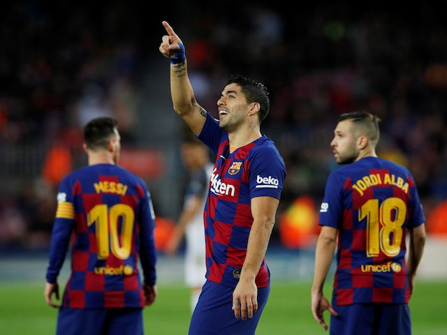 Barcelona's Luis Suarez celebrates scoring their fourth goal from the penalty spot on December 21, 2019