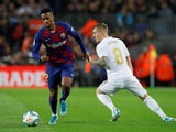 Barcelona's Nelson Semedo in action with Real Madrid's Toni Kroos in La Liga at Camp Nou on December 18, 2019