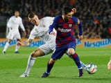Barcelona's Lionel Messi in action with Real Madrid's Toni Kroos in La Liga at Camp Nou on December 18, 2019