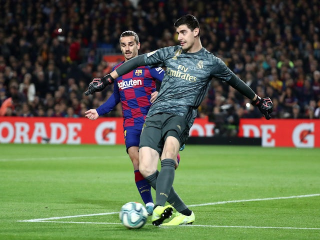 Barcelona's Antoine Griezmann in action with Real Madrid's Thibaut Courtois in La Liga at Camp Nou on December 18, 2019