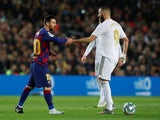 Barcelona's Lionel Messi in action with Real Madrid's Karim Benzema in La Liga at Camp Nou on December 18, 2019)