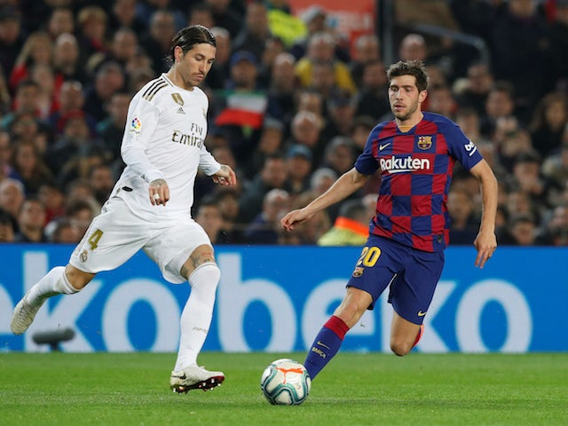 Barcelona's Sergi Roberto in action with Real Madrid's Sergio Ramos in La Liga at Camp Nou on December 18, 2019