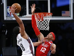 Brooklyn Nets guard Spencer Dinwiddie (8) goes up for a dunk against Philadelphia 76ers forward Tobias Harris (12) during the second half at Barclays Center on December 16, 2019