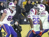 Buffalo Bills tight end Tyler Kroft (81) celebrates his touchdown with running back Devin Singletary (26) and offensive guard Quinton Spain (67) against the Pittsburgh Steelers during the fourth quarter at Heinz Field on December 16, 2019