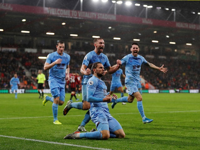 Burnley's Jay Rodriguez celebrates scoring their first goal with teammates on December 21, 2019