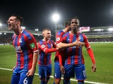 Crystal Palace's Wilfried Zaha celebrates scoring their first goal with teammates on December 16, 2019