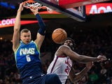 Dallas Mavericks forward Kristaps Porzingis (6) dunks the ball past Philadelphia 76ers center Joel Embiid (21) during the second quarter at Wells Fargo Center on December 21, 2019