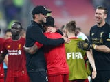 Jurgen Klopp celebrates with his players after Liverpool win the Club World Cup on December 21, 2019