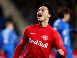 Takumi Minamino celebrates scoring for Salzburg on November 27, 2019