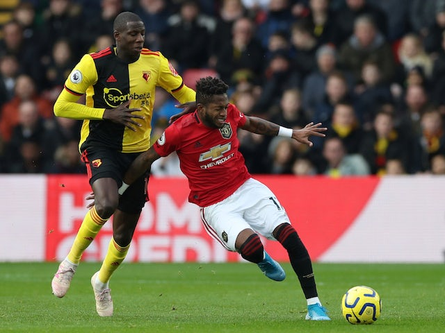 Watford's Abdoulaye Doucoure in action with Manchester United's Fred in the Premier League on December 22, 2019