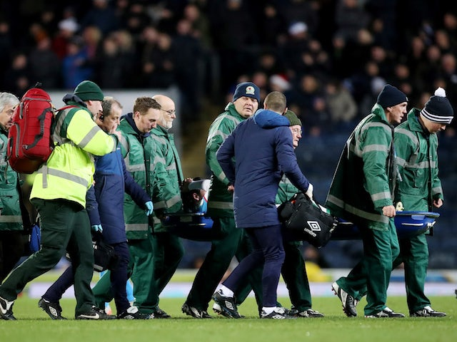 Blackburn Rovers' Bradley Dack receives medical attention after sustaining an injury on December 23, 2019